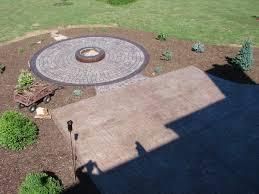 nice concrete patio with a connected concrete fire pit
