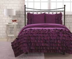 bedroom full size miley ruffle purple bedding set and white round bedside table and lamp
