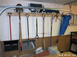 shelf diy suspended shelves garage storage attaching garage shelf tool rack garden tools hang on wall shovel snow
