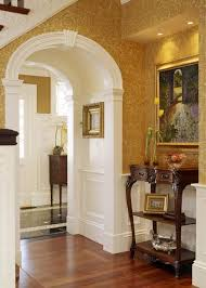 Classic interior design and decorating style with arched doorways and  vintage furniture