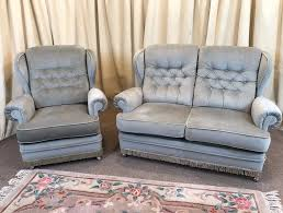2 piece suite green 2 seater sofa armchair high wing back free delivery available