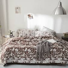 bronze brown and white dinosaur lion owl elephant palm tree print jungle safari animal themed full queen size bedding sets