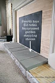 repurposed garden stepping stones for faux fireplace hearth blesser house featured on remodelaholic