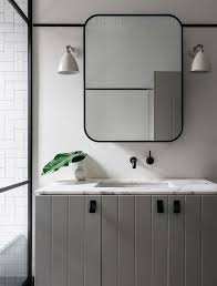 metal trim for bathroom mirrors. contemporary yet classic bath with unique styling on the marble vanity top; wall mounted black metal trim for bathroom mirrors o