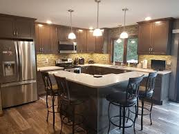 maple cabinets in a driftwood sn with everest quartz countertops