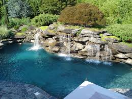 Natural looking in ground pools Underground Pool Landscape Patio Waterfall Natural Swimming Landscaping With Exotic Look Showing Stone Around Ideas Above Ground Wheats Landscape Pool Landscape Patio Waterfall Natural Swimming Landscaping With