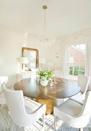 round gold base dining table with white velvet dining chairs