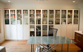 view in gallery simple and sleek bookshelf design with glass doors for the home office