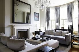 Outstanding modern classic living room with cushioned coffee table and gray  curtains on bay windows
