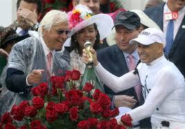 Jockey john velazquez, left, watches as trainer bob baffert holds up the winner's trophy after they victory with medina spirit in the 147th running of the kentucky derby at churchill downs, saturday, may 1, 2021, in louisville, ky. Bob Baffert Deflects Pressure Quietly Looks To Make History At Kentucky Derby Pittsburgh Post Gazette