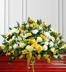 yellow sympathy casket spray