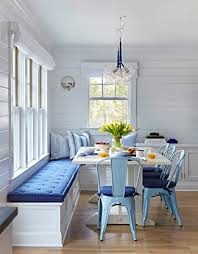 blue kitchen banquette light wood flooring bulb pendant lighting white square dining table pastel blue chairs