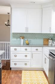 white shaker cabinets with quartz countertops. kitchen reveal - new white shaker style cabinets to quartz countertops that look like concrete and the gorgeous mint backsplash tiles. with e