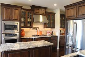 Burrows Cabinets Kitchen In Stained Knotty Alder And Soffit Above