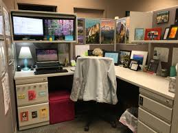 used the overhead storage in my cube to create my own standing desk cubicle decoration