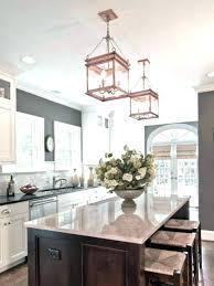 three light scroll chandelier lights kitchen island