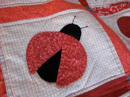 Under Construction: Ladybug applique quilt--very exciting & I'm very excited to let you know that the class launched today on her site.  Chris has been very patient and delightful to work with as I sorted through  how ... Adamdwight.com