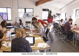 wide angle view busy design office. interior of busy design office with staff view preview wide angle o