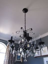 after shot of the painted chandelier in black