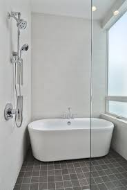 Minimalist White Bathroom with Elegant White FreeStanding Bathtubs from  Canada Stunning Seashore Residence Beachaus (I