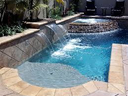 Indoor pool and hot tub Fancy Waterfall Pool With Ingroud Hot Tub Kayak 25 Impressive Inground Hot Tub And Pool Ideas For Your Home Carnahan