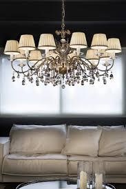 matt old gold crystal chandelier with cream shades masiero