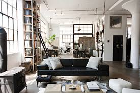 View in gallery Industrial New York living room with exposed pipes