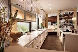 white maple cabinetry looks like its custom made but utilizes many stock units