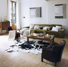 Living Room Faux Cowhide Rug For Retro Living Room Decor Plus Decorative  Pillows On Tan Sofa