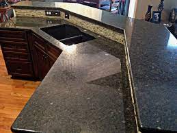 The primary color in this granite is brown; Coffee Brown Granite Kitchen Countertop Kitchen Island Counters