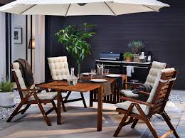 ikea outdoor furniture umbrella. A Backyard With Brown Reclining Chairs Beige Seat/back Cushions And A  Drop- Ikea Outdoor Furniture Umbrella