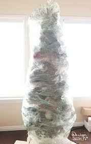 This year, wrap up your Christmas tree for easy storage! The BEST Christmas  decorating