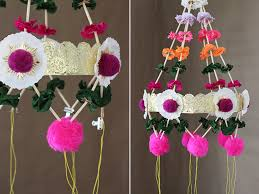 divide each set again with paper straws a set of crepe paper flowers and another straw one on each strand put alternating colors on each set so that