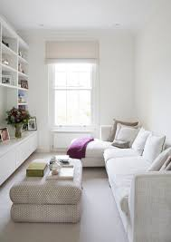 white living room furniture small. Small Living Room With White Long Sofa Pillows, Rug, Ottoman Furniture T