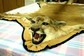 faux animal skin rugs uk fake rug large size of the picture for full lion
