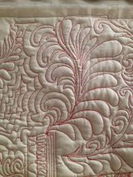 Irish Rose Creations & I enjoy custom work and large fill patterns both. Naturally large fill  patterns are less expensive, but they can produce very nice quilts. Adamdwight.com