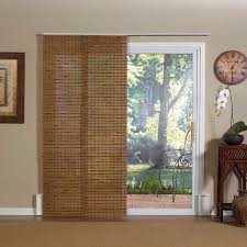 natural window covering for sliding glass door combined with cute wooden end table plus vintage clock