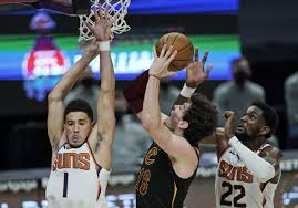 Booker scores 31, Suns dominate OT to ...