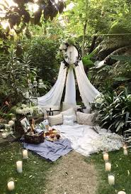 a beautiful styled romantic picnic for two in a secret garden setting ready for a