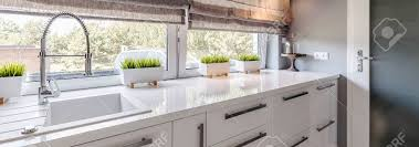 Closeup Shot Of A White Countertop In A Modern Kitchen Interior