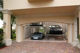 Modern Garage with Brick floors, French doors, Vaxcel Lighting OW38773LS  Lava Stone Essex 1