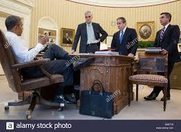oval office desks. US President Barack Obama Talks With Senior Advisors In The Oval Office Of White House Desks