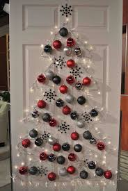 office decoration ideas for christmas. christmas decoration ideas designed by tree with white lamp and red silver black baubles hanging on wooden door office for