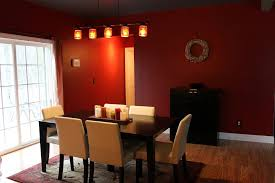 comfortable dining room design with rectangle dark wood dining table and cream dining chair also red wall color decor idea
