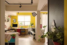 colorful home office. A Colorful Studio Apartment\u0027s Open Plan Bright Yellow Living Room | NONAGON.style Home Office E