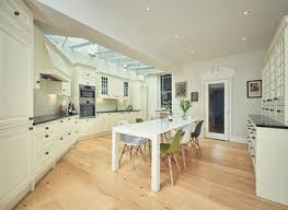 cream kitchen cabinets with black countertops. Kitchen : Delightful Cream Cabinets With Black Countertops C