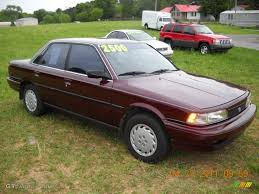 1991 Dark Red Pearl Metallic Toyota Camry Deluxe Sedan #48520569 ...