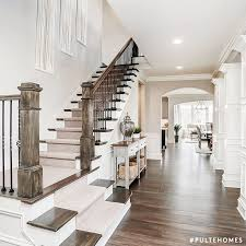 Using a color like SW 7015 Repose Gray on the walls of an open entryway like