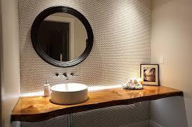 living edge lighting. stylish contemporary powder room with live edge vanity and penny tiled walls design blackfish living lighting e