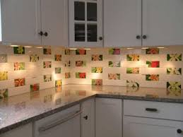 brightly white kitchen combined with colorful flower ceramic tile backsplash ideas for kitchen and glowing sand countertop paint kit also white kitchen